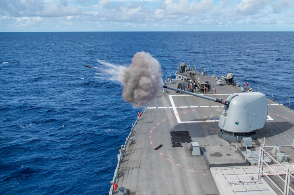 161007-N-UF697-158 PHILIPPINE SEA (Oct. 7, 2016) The forward-deployed Arleigh Burke-class guided-missile destroyer USS Barry (DDG 52) fires its 5-inch gun during a Pre-action Aim Calibration Fire (PACFIRE) exercise. Barry is on patrol with Carrier Strike Group Five (CSG 5) in the Philippine Sea supporting security and stability in the Indo-Asia-Pacific region. (U.S. Navy photo by Petty Officer 2nd Class Kevin V. Cunningham/Released)