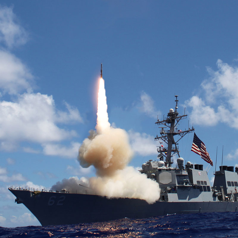 A missile is launching from a warship.
